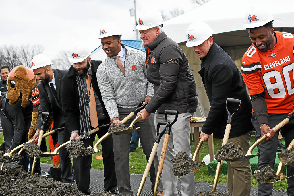 . From right, Cleveland Browns wide receiver Jarvis Landry, Lorain Mayor Chase Ritenauer, Browns Owner Jimmy Haslam,  Lorain City Schools CEO David Hardy Jr., and district Treasurer Josh Hill turn a shovel of dirt during a ground breaking event held at George Daniel Field, April 17, 2018. Through the generosity of the Cleveland Browns organization and Dee and Jimmy Haslam, Lorain High School athletes will be able to play sports on a high-quality synthetic turf field beginning this fall. (Eric Bonzar�The Morning Journal)