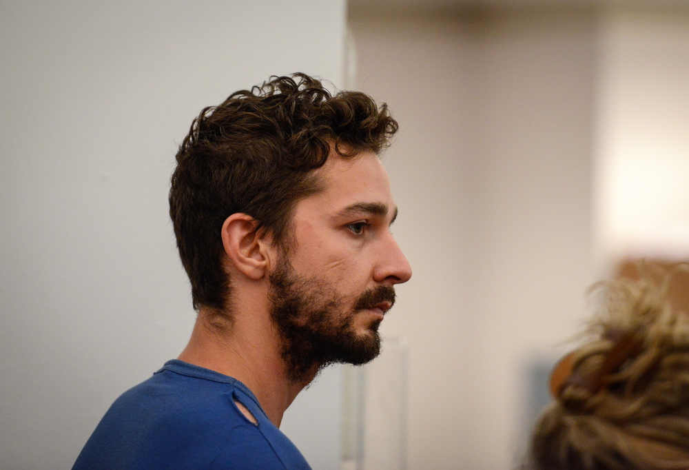 . Shia LaBeouf, represented by a Legal Aid attorney, is arraigned in Midtown Community Court, in New York, Friday, June 27, 2014. LaBeouf was released from police custody Friday after he was escorted from a Broadway theater for yelling obscenities and continued to act irrationally while being arrested, authorities said. He\'s due back in court July 24. (AP Photo/Daily News, Anthony DelMundo, Pool)