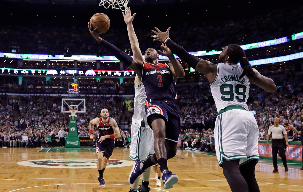 . Washington Wizards guard John Wall (2) threads past Boston Celtics forward Jae Crowder (99) on a drive to the basket during the second quarter of a second-round NBA playoff series basketball game in Boston, Tuesday, May 2, 2017. (AP Photo/Charles Krupa)