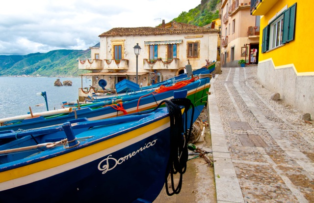 Colorful boats line the harbor in an Italian harbor.