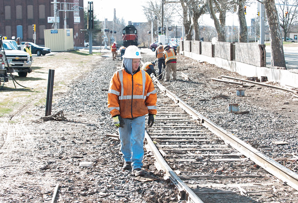 04/05/18 Wesley Bunnell   Staff Pan-Am crews are on the scene of a train derailment on Thursday morning in front of Columbus Plaza assessing and making repairs to the tracks. The site was also the scene of a derailment in 2016. A worker walks the tracks looking for broken wooden railroad ties underneath the tracks.