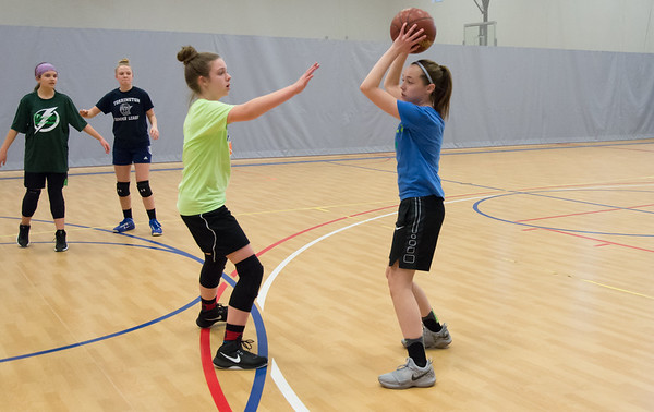 02/011/19 Wesley Bunnell | Staff Members of the girls 7th and 8th grade St. Joseph's basketball team practiced at the Bristol Boys and Girls Club on Monday afternoon. Sara Roberts, L, guards Maddie Pikiell.