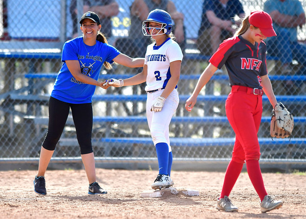 6/8/2019 Mike Orazzi | Staff Southington's Davina Hernandez with Chrisala Marotto (2) and NFA's Julie Vincent ? (9) during Saturday's Class LL Softball Final at DeLuca Field in Stratford. .