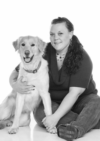 Amber and her dog pose for a portrait.
