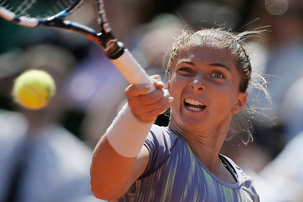 . Italy\'s Sara Errani returns against Poland\'s Agniezska Radwanska, defeating her in two sets, 6-4, 7-6, in their quarterfinal match at the French Open tennis tournament, at Roland Garros stadium in Paris, Tuesday June 4, 2013. (AP Photo/Petr David Josek)