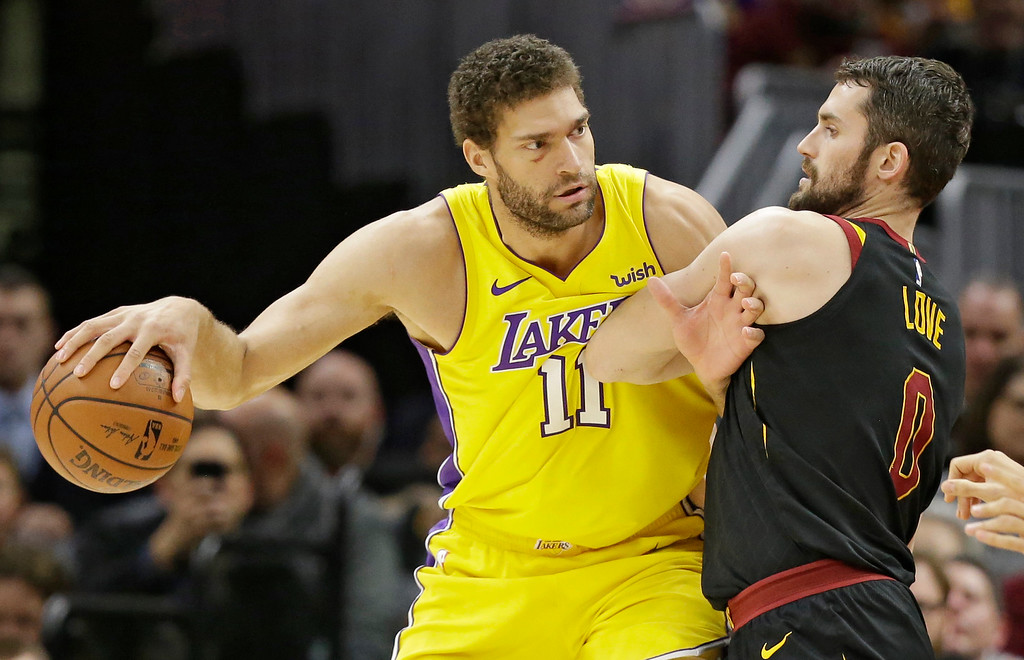 . Los Angeles Lakers\' Brook Lopez (11) drives past Cleveland Cavaliers\' Kevin Love (0) in the first half of an NBA basketball game, Thursday, Dec. 14, 2017, in Cleveland. (AP Photo/Tony Dejak)