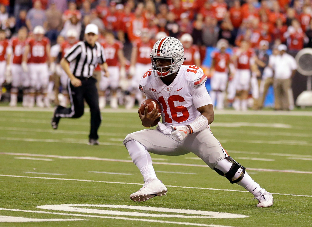 . Ohio State quarterback J.T. Barrett runs with the ball during the second half of the Big Ten championship NCAA college football game against Wisconsin, Saturday, Dec. 2, 2017, in Indianapolis. (AP Photo/Michael Conroy)