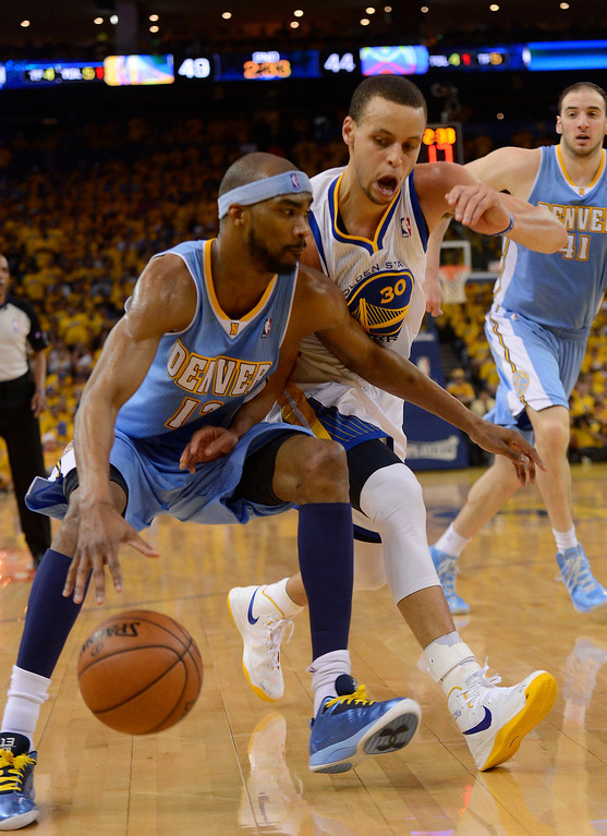. OAKLAND, CA - APRIL 28:Corey Brewer (13) of the Denver Nuggets drives on Stephen Curry (30) of the Golden State Warriors during the second quarter in Game 3 of the first round NBA Playoffs April 28, 2013 at Oracle Arena. (Photo By John Leyba/The Denver Post)