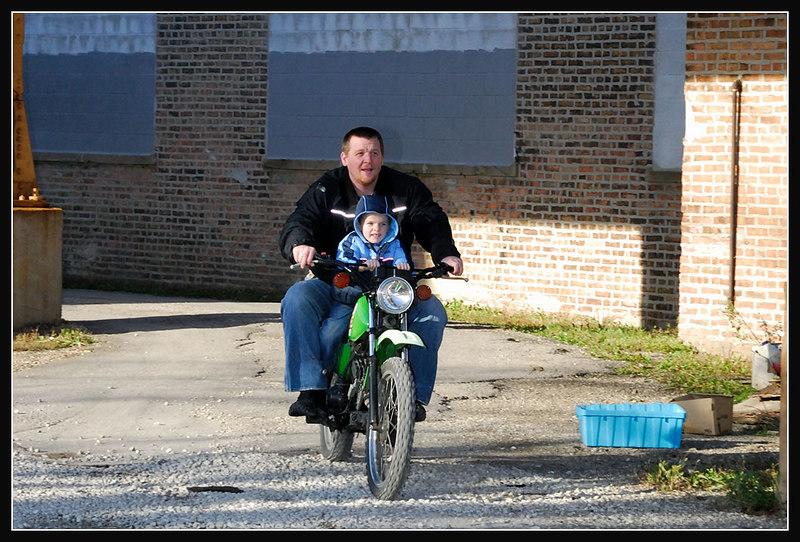 "My favorite nephew riding on my lap around my ""yard"" in the city.."