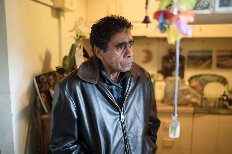 Aboriginal Man in a Leather Jacket in a Kitchen