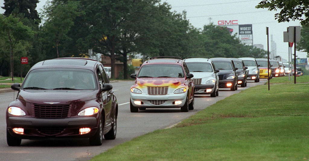 . Hundreds of PT Cruisers make their way down Woodward Ave. twords Royal Oak to kick-off an early start to this year\'s Dream Cruise.