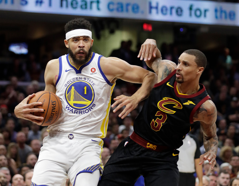 . Golden State Warriors\' JaVale McGee is defended by Cleveland Cavaliers\' George Hill in the first half of Game 4 of basketball\'s NBA Finals, Friday, June 8, 2018, in Cleveland. (AP Photo/Tony Dejak)