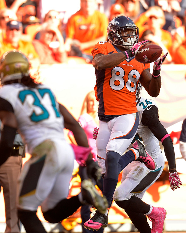 . Denver Broncos wide receiver Demaryius Thomas (88) makes a catch in the fourth quarter. The Denver Broncos take on the Jacksonville Jaguars at Sports Authority Field at Mile High in Denver on October 13, 2013. (Photo by John Leyba/The Denver Post)