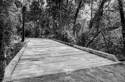 Kahney's Crossing is 1 of over 20 bridges constructed by Bayou Land Conservancy  Trail Crew volunteers along the Spring Creek Nature Trail near The Woodlands, Texas.  At 29 feet long it is one of the largest bridges constructed along the trail.