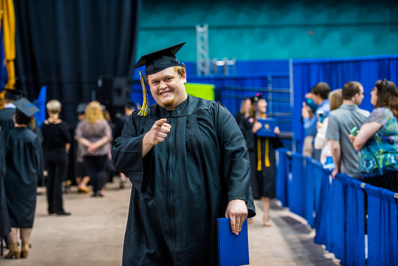 Journalism student Aaron Walling poses for a picture during Commencement 2017.