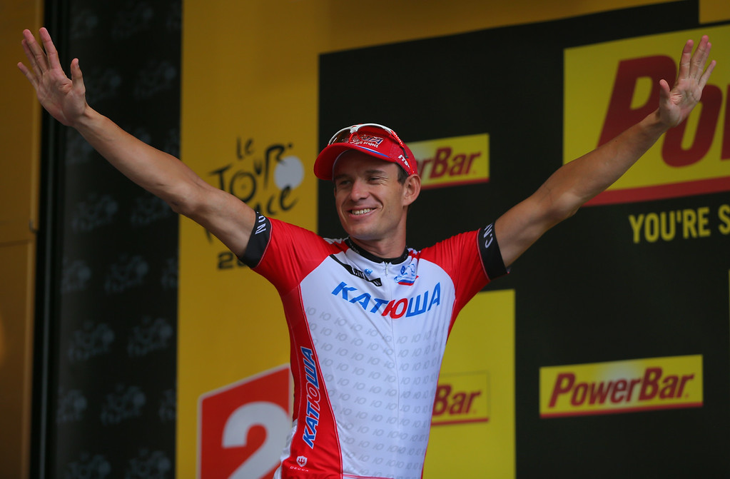 . Alexander Kristoff of Noraway and Team Katusha celebrates on the podium after winning the fifteenth stage of the 2014 Tour de France, a 222km stage between Tallard and Nimes, on July 20, 2014 in Nimes, France.  (Photo by Doug Pensinger/Getty Images)