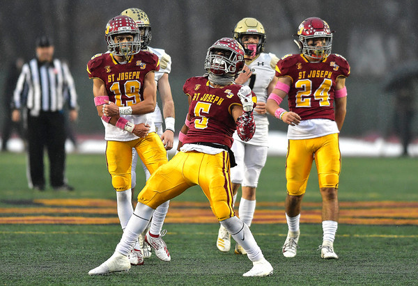 12/14/2019 Mike Orazzi | Staff St. Joseph High School's Davee Silas (5) celebrates a sack during 17 win over Daniel Hand at Veteran's Stadium in New Britain on Saturday.