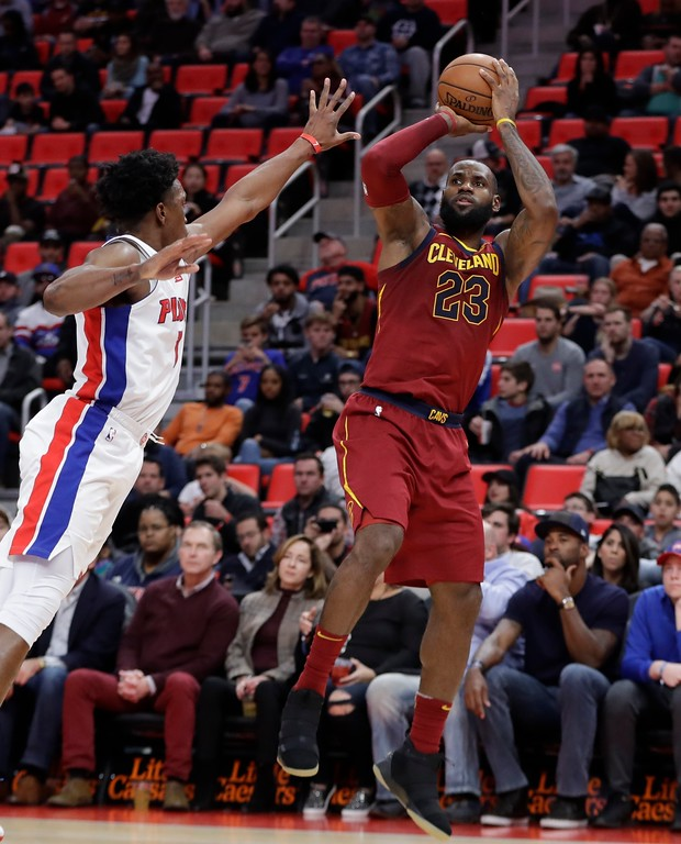 . Cleveland Cavaliers forward LeBron James (23) shoots as Detroit Pistons forward Stanley Johnson defends during the second half of an NBA basketball game, Monday, Nov. 20, 2017, in Detroit. (AP Photo/Carlos Osorio)
