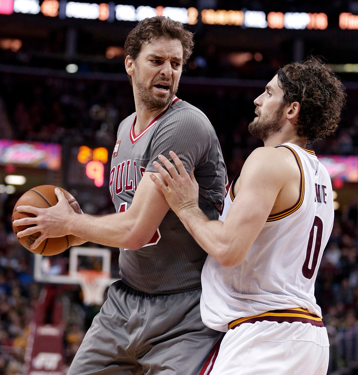 . Chicago Bulls� Pau Gasol (16) drives past Cleveland Cavaliers\' Kevin Love (0) during the second half of an NBA basketball game Saturday, Jan. 23, 2016, in Cleveland. Gasol scored a team-high 25 points in the Bulls\' 96-83 win. (AP Photo/Tony Dejak)