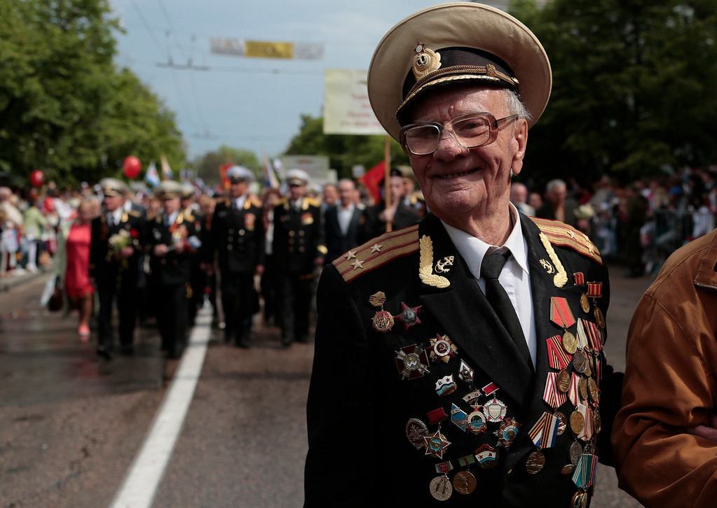 . A WWII veteran walks during a Victory Day parade in Sevastopol, Crimea, Friday, May 9, 2014. Crimea, which hosts a major Russian Black Sea Fleet base, is also set to hold a massive navy parade in the port of Sevastopol, celebrating the Russian takeover. (AP Photo/Ivan Sekretarev)