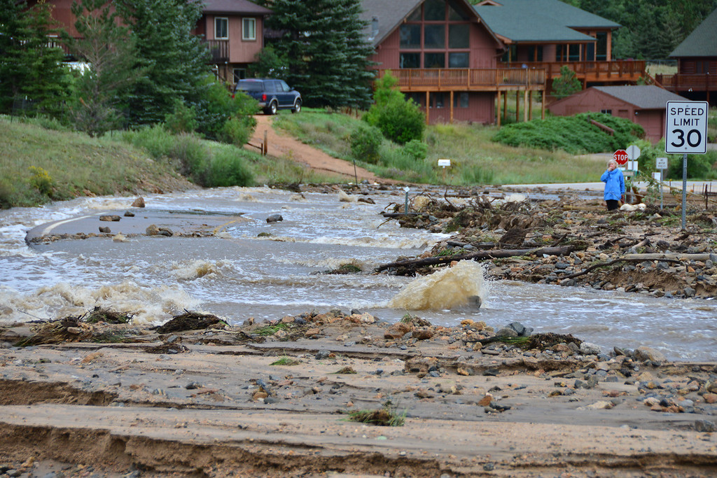 . Fish Creek was a raging torrent flowing down Fish Creek Road Saturday morning, Sept 14, 2013. Officials said as of Saturday the creek had breached its banks in nine locations. John Cordsen/Estes Park Trail-Gazette