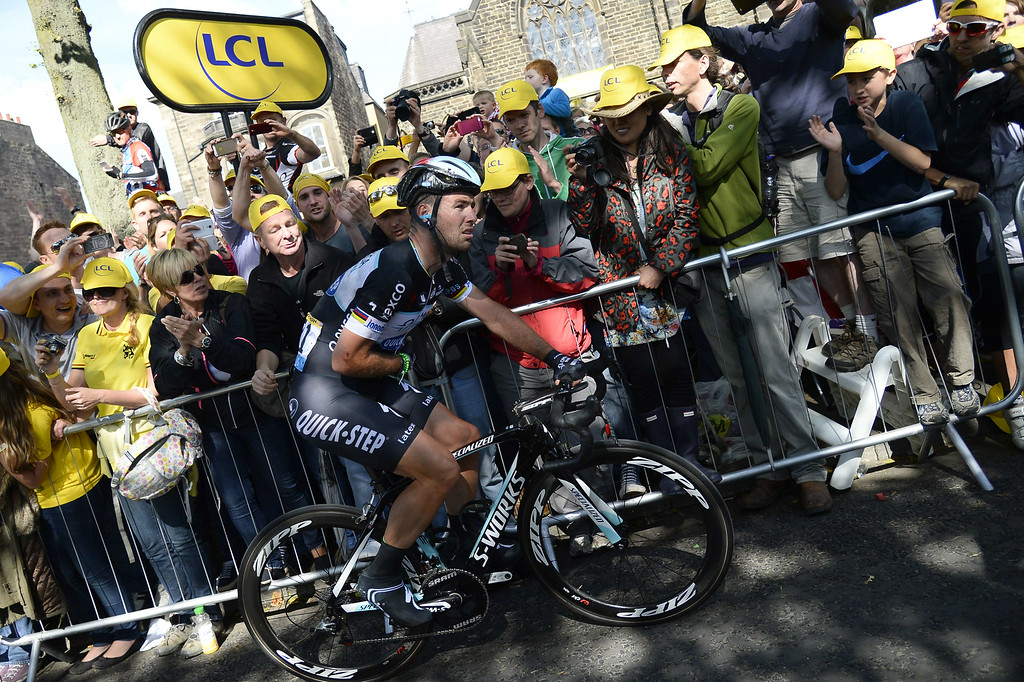 . Britain\'s Mark Cavendish, injured, crosses the finish line at the end of the 190.5 km first stage of the 101st edition of the Tour de France cycling race on July 5, 2014 between Leeds and Harrogate, northern England.  The 2014 Tour de France gets underway on July 5 in the streets of Leeds and ends on July 27 down the Champs-Elysees in Paris.  LIONEL BONAVENTURE/AFP/Getty Images