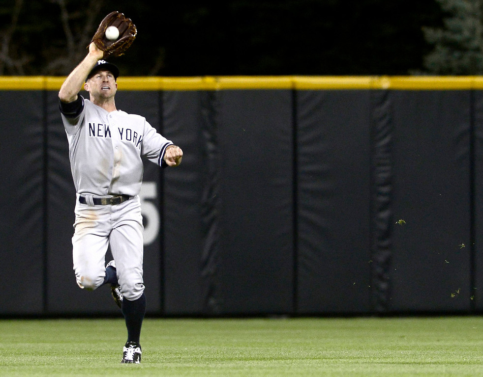 . New York Yankees\' Brett Gardner makes a running catch against the Colorado Rockies during their inter-league MLB baseball game in Denver, Colorado May 8, 2013.   REUTERS/Mark Leffingwell