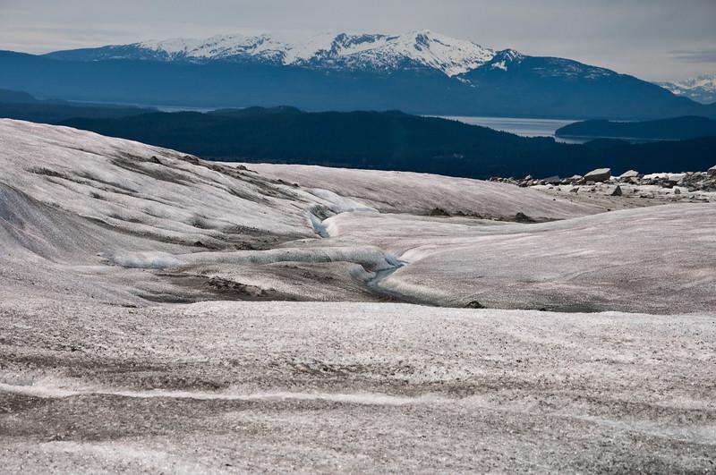 Crevices flow through the glacier.