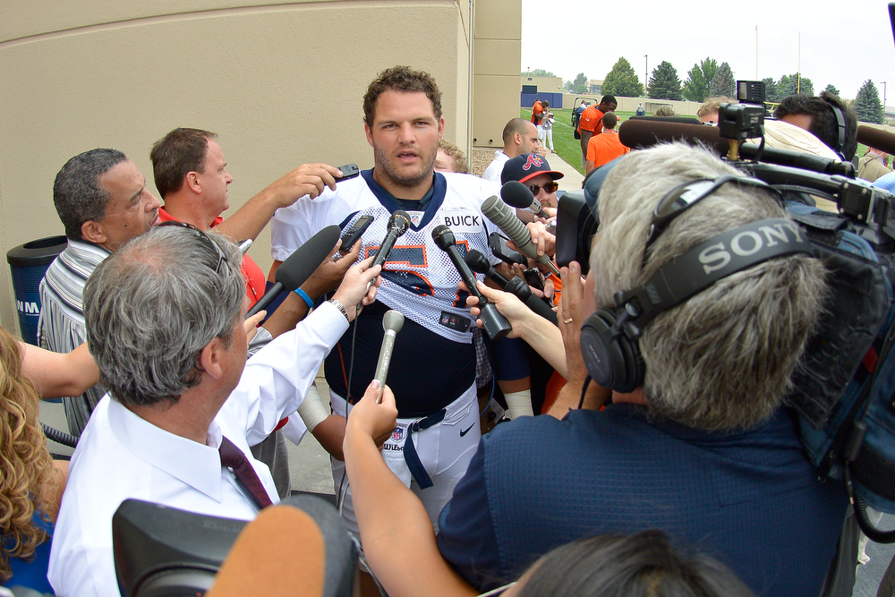 . Denver Broncos Steve Vallos (51) talks with the media after practice during training camp July 29, 2013 at Dove Valley. Vallos was the newly acquired center for the Broncos after Dan Koppen went dow with a season ending injury. (Photo By John Leyba/The Denver Post)