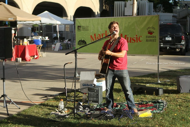Iowa City, IA- Musician Dennis Florine performs in the Chauncey Swan Park on Wednesday, June 20, 2012. This event is part of Market Music, held to entertain participants at the Iowa City Farmers Market on Wednesdays (5-7pm) and on Saturdays (9-11am). Florine will perform in Wetherby Park at 6:30 p.m., June 21 as part of Party in the Park, and Martinis at 8:00 p.m., June 29. (The Daily Iowan/Sumei Chen)