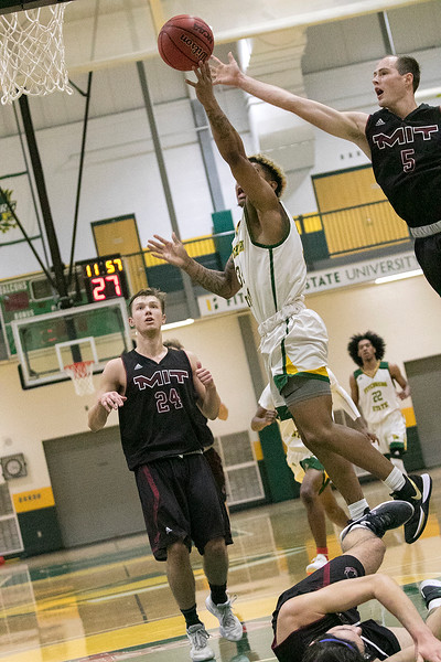 Fitchburg State University played Massachusetts Institute of Technology on Saturday, Dec. 7, 2019 at FSU's Recreation Center. MIT's #5 Ian Hinkley tries to stop a shot by FSU's #34 Anthony Diaz. SENTINEL & ENTERPRISE/JOHN LOVE