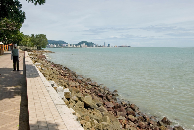 View of the sea and city skyline from the shore in George Town, Penang, Malaysia