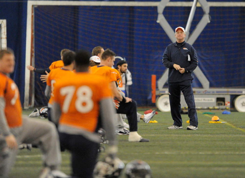 . Denver Broncos head coach John Fox looks on during practice under the dome Wednesday, December 19, 2012 at Dove Valley as they prepare for the Cleveland Browns.  John Leyba, The Denver Post