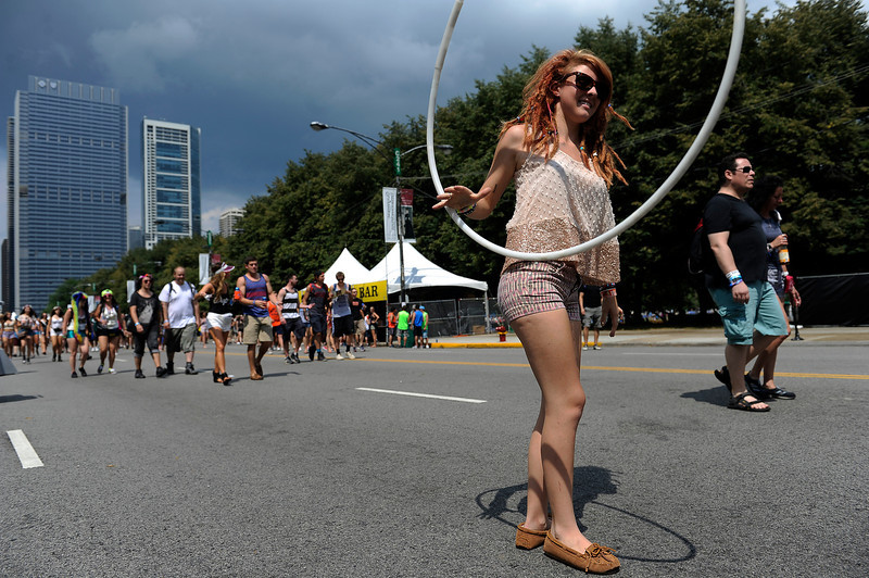 . A woman hula hoops near the Perry\'s stage during Lollapalooza at Grant Park on August 2, 2013 in Chicago, Illinois. (Photo by Seth McConnell/The Denver Post)
