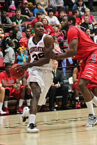 Jerome Hill(35) passes his opponent for a layup.