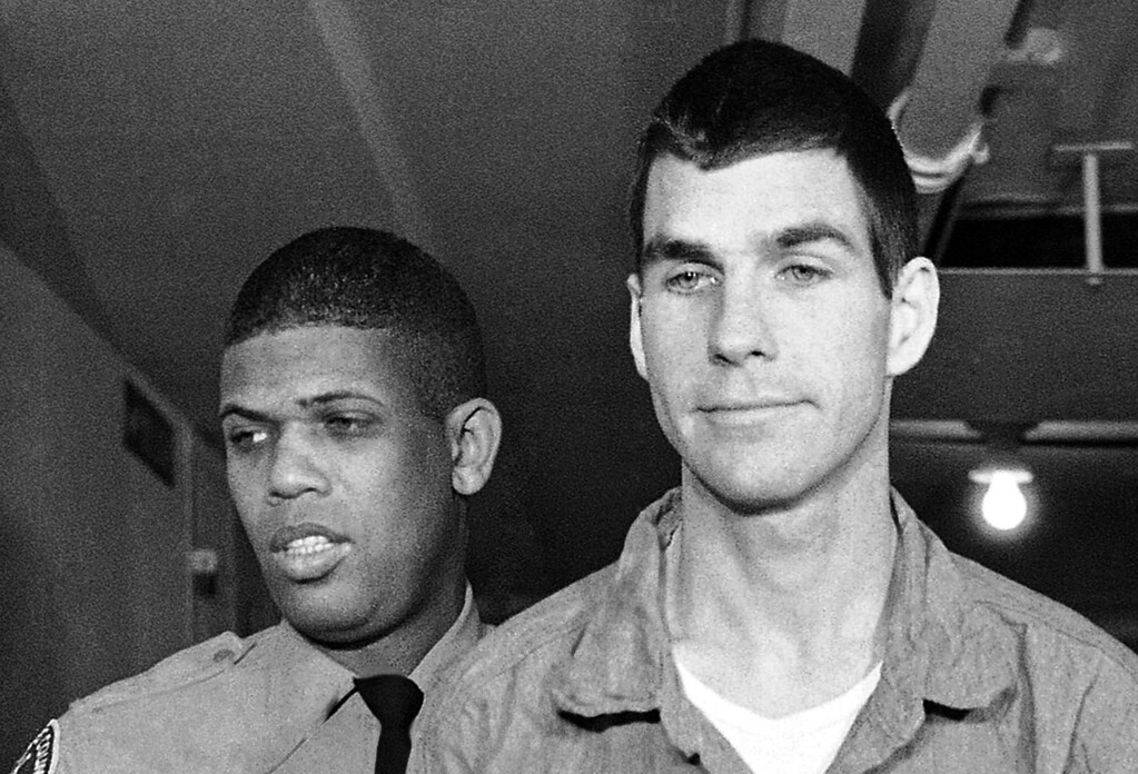 . FILE - This March 1, 1971, file photo shows Charles Tex Watson, right, arriving for court in Los Angeles, Calif. A Texas judge is expected to decide Tuesday, May 29, 2012, whether eight hours of audio recordings of conversations between a the former Manson family member and his attorney should be given to Los Angeles police. Watson is serving a life sentence for his role in the 1969 Tate-La Bianca murders. (AP Photo/Wally Fong, File)