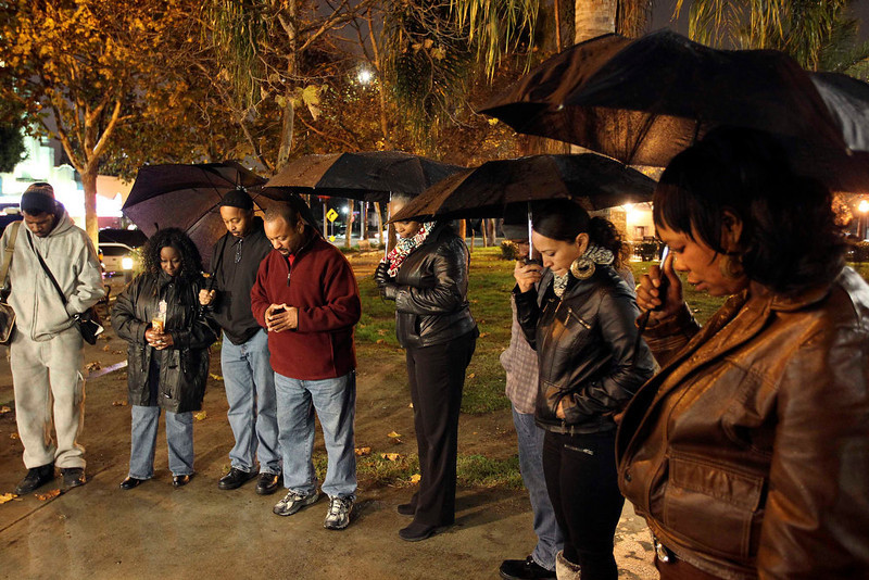 . People pray at a candlelight vigil in memory of those killed in a mass shooting at Sandy Hook Elementary School in Connecticut, in Los Angeles, California, December 14, 2012. A heavily armed gunman opened fire on school children and staff at a Connecticut elementary school on Friday, killing at least 28 people, including 20 children, in the latest in a series of shooting rampages that have tormented the United States this year. REUTERS/David McNew