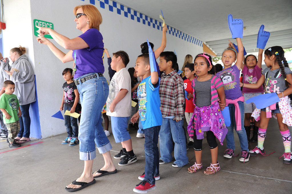 """. (John Valenzuela/Staff Photographer)  Lugonia Elementary in Redlands celebrated its 808 API score, Thursday, with a pep rally at the school, September 26, 2013.  The Citrus Valley Marching Band was on hand to help celebrate, in honor of the event all of the school staff wear purple shirts with the words \""""800 Club\"""" on the back."""
