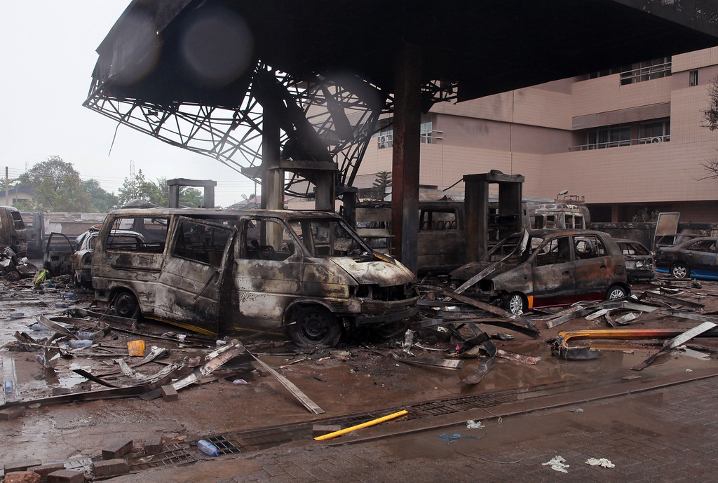 . The remaining structure of a gas station after it exploded in Accra, Ghana, Thursday, June 4, 2015. Flooding in Ghana\'s capital swept stored fuel into a nearby fire, setting off a huge explosion at a gas station that killed dozens of people and set alight neighboring buildings, authorities said Thursday. (AP Photo/Christian Thompson)