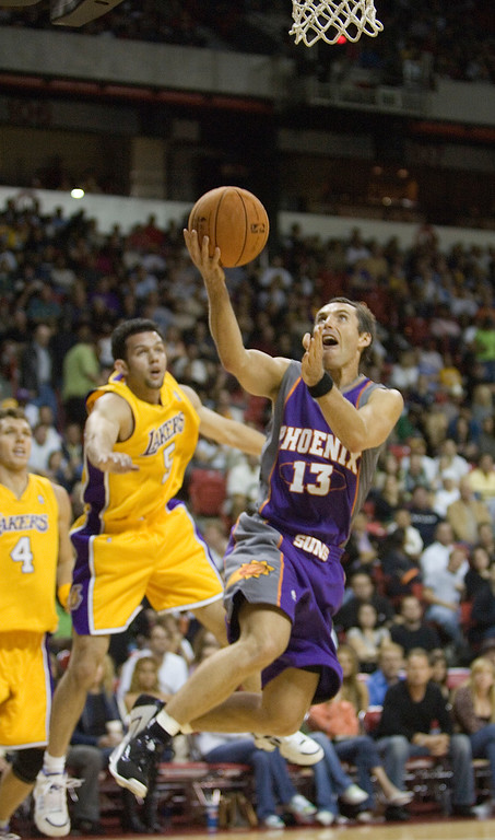 . Phoenix Suns\' Steve Nash (13) drives to the basket during the first half of an NBA preseason basketball game against the Los Angeles Lakers at the Thomas & Mack Center in Las Vegas, Sunday, Oct. 15, 2006. (AP Photo/Clint Karlsen)