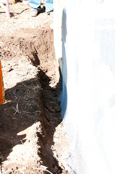 This over exposed photo shows how a trench was dug around the coop a foot deep....by 'Yours Truly' to make the coop really safe from digging animals who might try to get in.