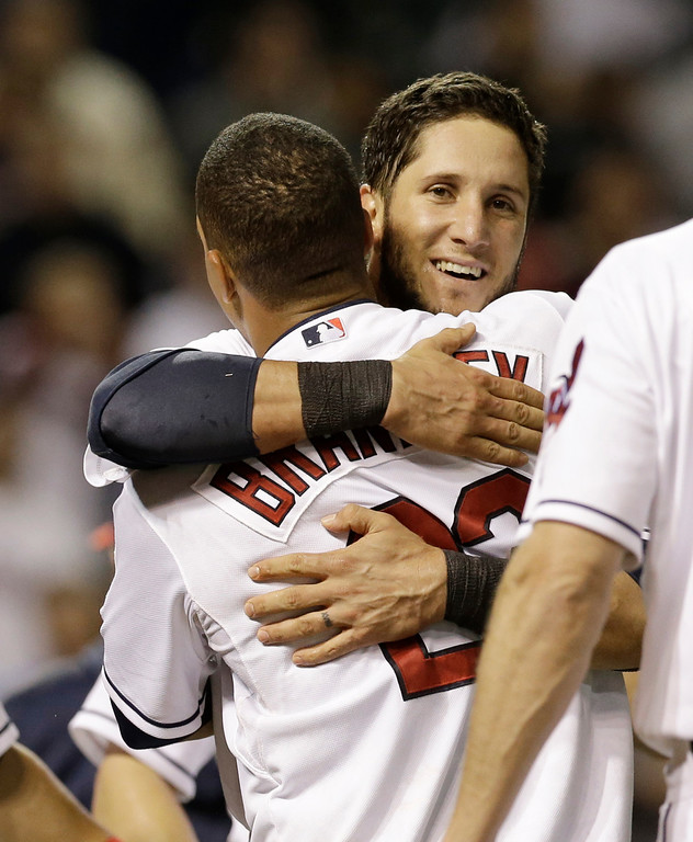 . Cleveland Indians\' Yan Gomes, right, hugs Michael Brantley after Brantley hit a game-winning solo home run off Detroit Tigers relief pitcher Al Alburquerque in the tenth inning of a baseball game, Monday, May 19, 2014, in Cleveland. (AP Photo/Tony Dejak)