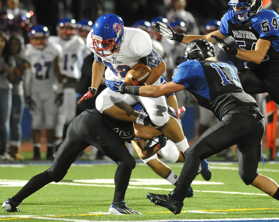 . Los Altos runningback Matthew Hayashi (#32) is tripped up by Diamond Ranch defenders in their Hacienda League opener football game at Diamond Ranch High School in Pomona on Friday October 4, 2013. (San Gabriel Valley Tribune/Staff Photo by Keith Durflinger)