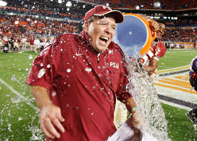 . Florida State Seminoles head coach Jimbo Fisher is splashed with Gatorade by quarterback Jameis Winston after their team defeated the Northern Illinois Huskies during their 2013 Discover Orange Bowl NCAA football game in Miami, Florida January 1, 2013.    REUTERS/Jeff Haynes