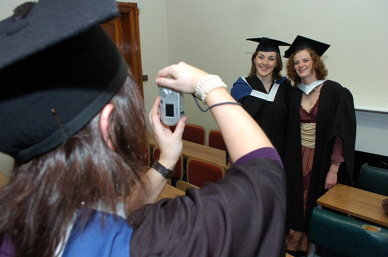 Provision 251006 Maria Conroy (Dungarvan) and Clare Balfe (Longford) have their photo taken by their classmate Noelle Griffith before they go into their graduation ceremony in WIT yesterday (Weds). Both graduated with a BA in Art. PIC Bernie Keating/Provision