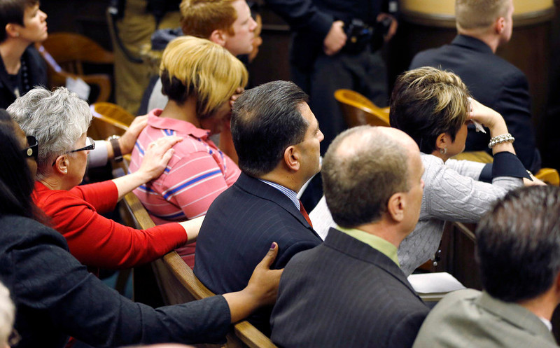 . Family members console each other as Judge Thomas Lipps (not shown) delivers the verdicts in the trial of Ma\'lik Richmond, 16 and Trent Mays, 17, in juvenile court in Steubenville, Ohio, March 17, 2013. Mays and  Richmond were found guilty of raping a 16-year-old girl at a party last summer while she was in a drunken stupor in a case that gained national exposure through social media. REUTERS/Keith Srakocic/Pool