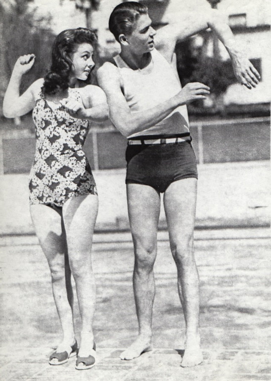 """. Ronald Reaganis giving a swimming lesson to the late actress Susan Hayward when both were breaking into the movies and in the film, \""""Girls on Probation,\"""" in 1938.  The cheesecake and beefcake poses were publicity shots, according to Beverly Linet, Author of the book:\""""Susan Hayward; Portrait of a Survivor.\"""" They were such unknowns at the time the photo was never published. According to the caption with this handout photo Reagan and Miss Hayward didn\'t particulary like each other. (Los Angeles Daily News file photo)"""