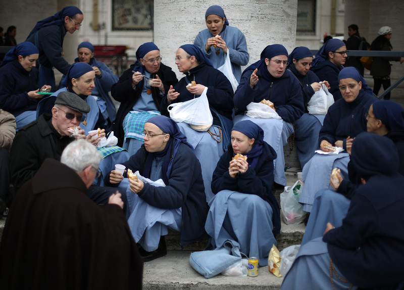 . Members of the Communtity of the Little Sisters of the Lamb enjoy lunch in St Peter\'s Square after Pope Francis gave his first Angelus blessing on March 17, 2013 in Vatican City, Vatican. The Vatican is preparing for the inauguration of Pope Francis on March 19, 2013 in St Peter\'s Square.  (Photo by Peter Macdiarmid/Getty Images)
