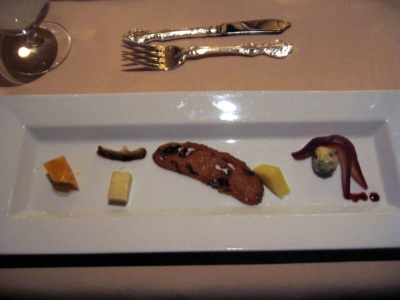 Fifth Course (from left): Gouda Reypanaer VSOP with Tupelo Honey; Colston Bassett Stilton with pears soaked in burgundy port.  (I kept the camera flash off so as not to disturb other patrons.)
