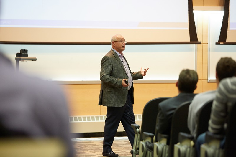 Activity; Speaking; Buildings; Centennial; Location; Inside; Classroom; Objects; Projector; People; Alumni; Fall; October; Time/Weather; day; Type of Photography; Candid; UWL UW-L UW-La Crosse University of Wisconsin-La Crosse; Distinguished Lecture series Harry Blount CBA
